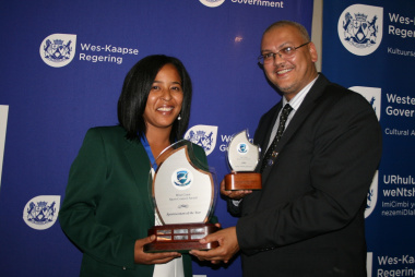 Audrey Lawrence (West Coast Sportswoman of the Year) and Adv. Lyndon Bouah (Department of Cultural Affairs and Sport).