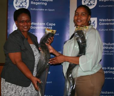 Author and adjudicator Ms Fikiswa Magqashela received a kuduzela from Ms Beaulla Stofile (DCAS).
