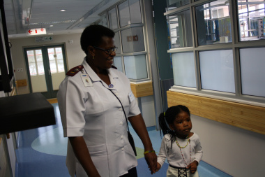 Sr Lindiwe Teto, Operational Manager: Ward B2, gives patient Lindokuhle Dlakavu a guided tour of the newly upgraded ward.