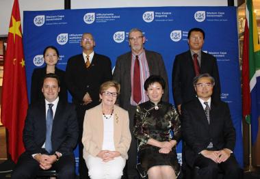 Back left: Li Xiao, Adv. Lyndon Bouah, Adv. Brent Gerber, Zhang Yong  Front: Gareth Bloor, Belinda Walker, Luan Xin (Vice Mayor of Qingdao) and Lian Shugen (Consul General of China).