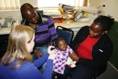 Mpilontle Maso is fitted with a hearing device.