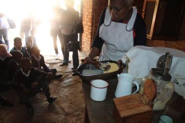 Brenda Matsau demonstrates how to make butter
