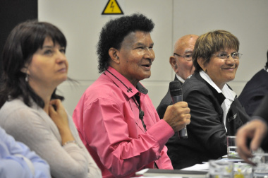 Bus operators interact with Minister Grant at the conference.