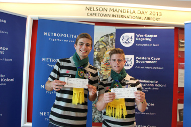 Byron McKellar and Dean Kowalski show off their tickets to China.