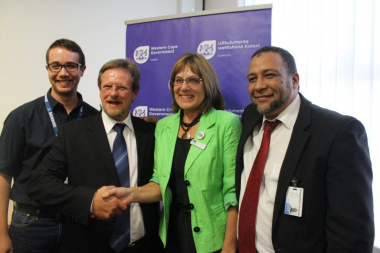 Two of the Champions of the C2AIR2 Club Challenge, Mr Donovan Hopkins (left), and Dr. Erma Mostert (second right) with Mr Theuns Botha, Western Cape Minister of Health (second left), and Dr Anwar Kharwa (CEO Khayelitsha Hospital).