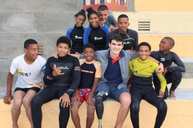 Caleb Swanepoel, shark attack survivor with children from the 9Miles project.