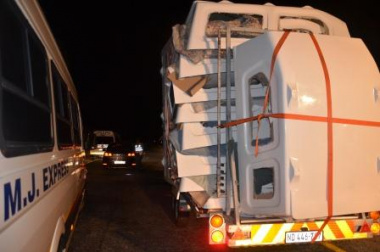 A bakkie loaded with canopies.