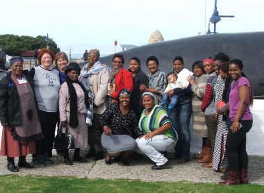 Caregivers from Lombardi Service Centre in Mount Pleasant and the Siyazama Service Centre in Zwelihle with Museum Staff