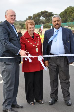 Minister Carlisle, Ms Rosil Jager, the Mayor of the Saldanha Bay Municipality, and Mr Harold Cleophas, the Mayor of the West Coast District Municipality, cut the ribbon across the MR 559.
