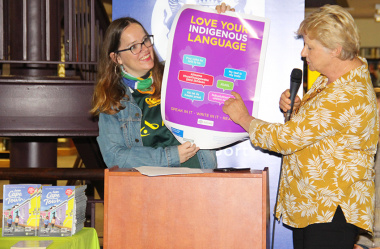 Cecilia Sani and Helga Fraser show a new poster promoting the use of indigenous languages.