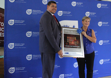 Cederberg Municipality Mayor William Farmer receives a framed poster from Minister Anroux Marais at the launch of the Oral History Initiative