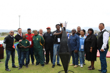 Chaney Willemse from Boland Cavaliers lights the Olympic Torch, as dignitaries from the Western Cape Sport Federation and Stellenbosch Municipality look on.