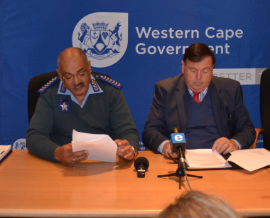 Traffic Chief Kenny Africa and Minister Donald Grant at the media briefing.