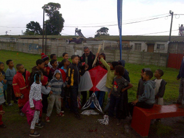 Children are taught how to build kites