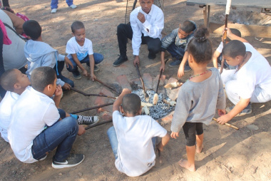 Children from the local community baking stick bread during one of the activities