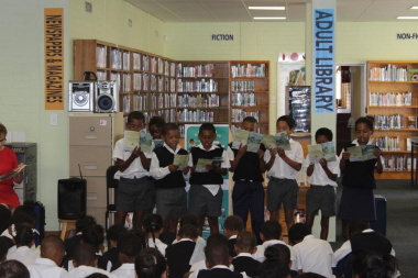 Children participating in a reading session inside the new library