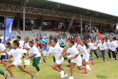 Children take off for the Olympic Day Fun Run.