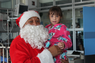 Hope Ferreira (6) from Alberton was very happy to see Father Christmas and couldn't wait to give him a hug.