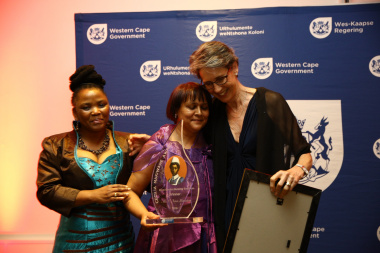 Western Cape Government Health Minister, Dr Nomafrench Mbombo congratulating Sr van Heerden with the Head of Health, Dr Beth Engelbrecht.