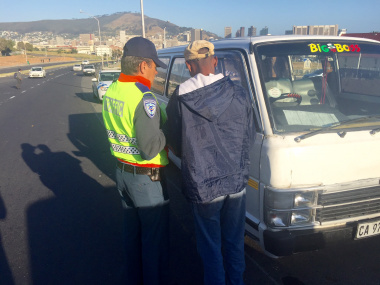 City of Cape Town traffic officer with driver of impounded vehicle.