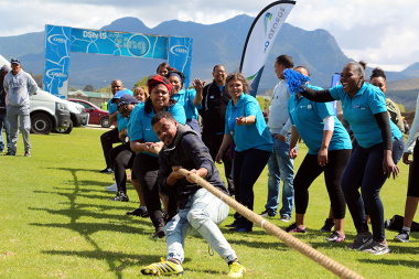 Colleagues cheering for Team Health at tug-of-war