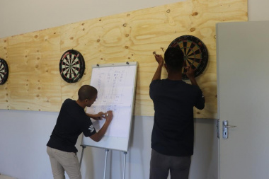 Eager competitors wrap up a dart game at the BTG Games in Caledon
