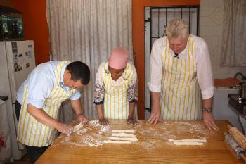 Ministers Ivan Meyer and Alan Winde participate in one of Faldela Tolker's cooking lessons.