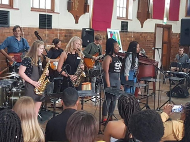 Minister Anroux Marais with articipating students at the Youth in Music Excellence Initiative hosted by the Cape Town Music Academy (CTMA) as part of the Toyota US Woordfees