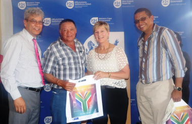 David Slinger (second from left) from Tankwa Karoo receiving his DVD from Minister Marais