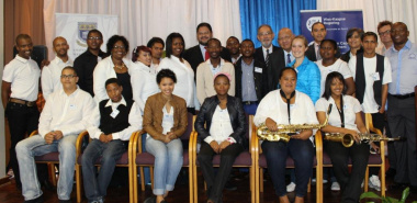 DCAS and UWC representatives with students participating in the Music Development Programme.