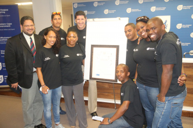 At the back are Head of Department Brent Walters, Rory Kleineveldt, Ernst van Dyk, Cedric Finch, Andrea Dondolo and Siv Ngesi. In front are Leandra Smeda, Dr Nomafrench Mbombo and Lungile Tsolekile.