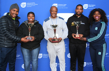 DCAS Deputy Director Philasande Macwili and Rosie Makhumalo, Kgati Western Cape Chairperson with the overall regional winners of the games