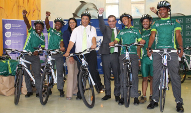 DCAS, Nedbank and Sports Trust staff pose with development cyclists.