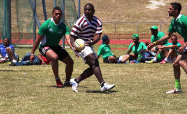 DCAS vs Health in a fervent touch rugby game.