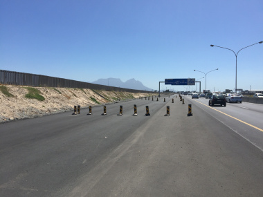Delineators keep traffic off areas under construction.