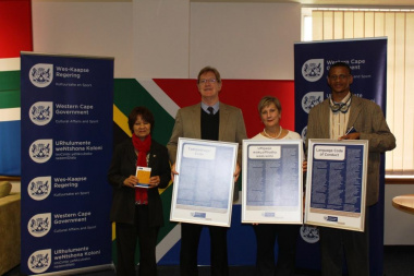 Deputy Chair of the Language Committee, Ria Olivier with Quintus van der Merwe, Minister Marais and Xolisa Tshongolo
