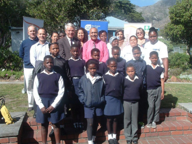 Deputy Minister Cronin with officials from Public Works, DCAS, Hout Bay Museum and learners from two local schools.