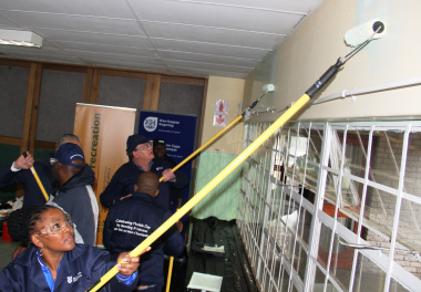 SRSA deputy minister Gert Oosthuizen and Dr Nomafrench Mbombo paint the Salvation Army Crèche in Manenberg.