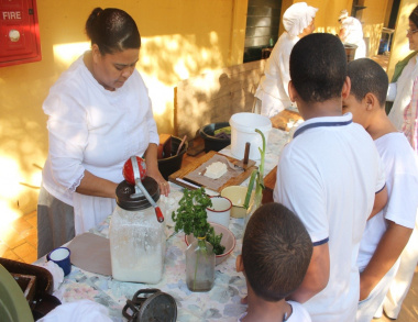 Desmonia Claassen making butter and cottage cheese