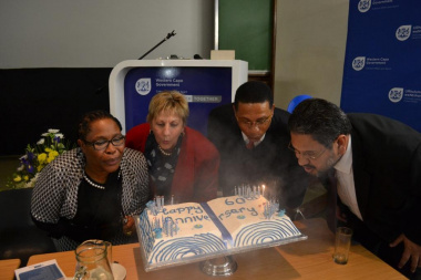 Director Nomaza Dingayo, Minister Anroux Marais, Minister of Finance Dr Ivan Meyer and HOD Walters blowing out the birthday candles