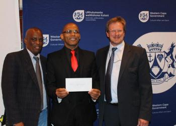Director of DCAS Sport Promotion, Thabo Tutu, Rudi Johannes, Chairman of Overberg District Sport Council, and Minister of Cultural Affairs and Sport, Theuns Botha