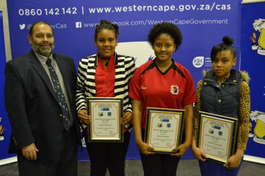 Director Paul Hendricks with the nominees for school sportswoman of the year at the Overberg Sports Awards