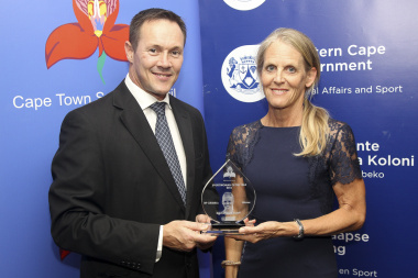 Dominique Scott receives her trophy for Sportswoman of the Year from JP Naude
