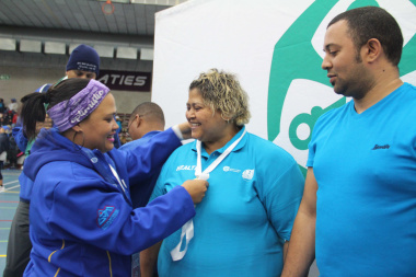 Dominoes tournament winners Marina de Jager (centre) and Nolan  Meyer from the Department of Health receive their gold medals