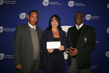 Dr Ivan Meyer, Ms Lizelle Erasmus (SWD Netball) and Mr Goliath Munro (SWD Sport Council) at the cheque handover ceremony.