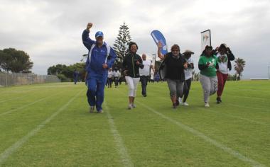Dr Lyndon Boauh reaching the finish line of the fun run.