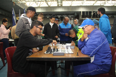 Dr Lyndon Bouah (right), chief director of Sport and Recreation at DCAS, considers his next move during a chess match