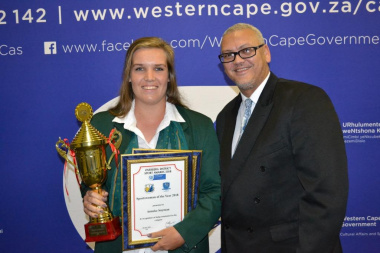 Dr Lyndon Bouah with sportswoman of the year winner Anneke Snyman at the Overberg Sport Awards