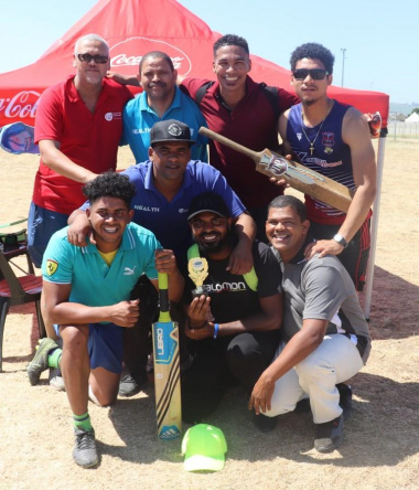 DCAS Dr Lyndon Bouah with the cricket winners towards the end of the day at the Metro Better Together Games in Bluedowns