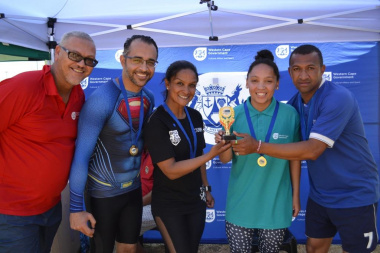 DCAS Dr Lyndon Bouah with the mixed relay winners at the Metro Better Together Games in Bluedowns